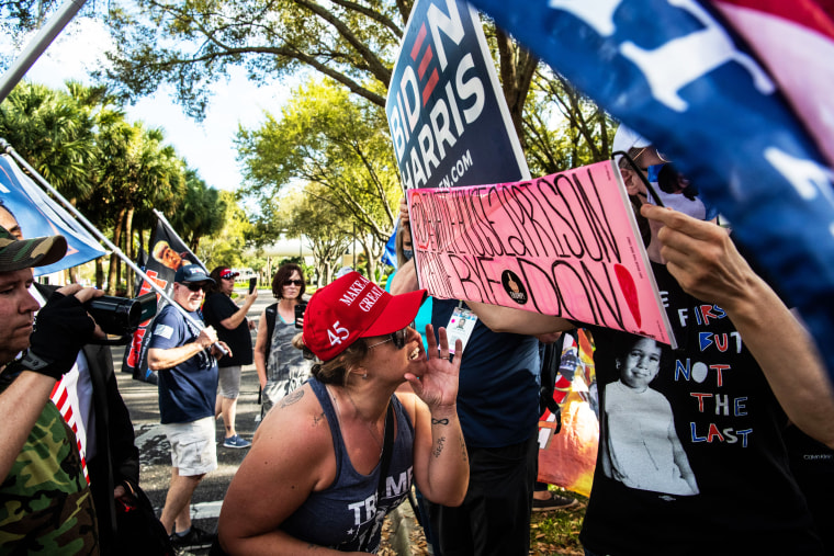 A supporter of former President Donald Trump screams at President Biden supporters outside the Conservative Political Action Conference in Orlando on Feb. 28, 2021.