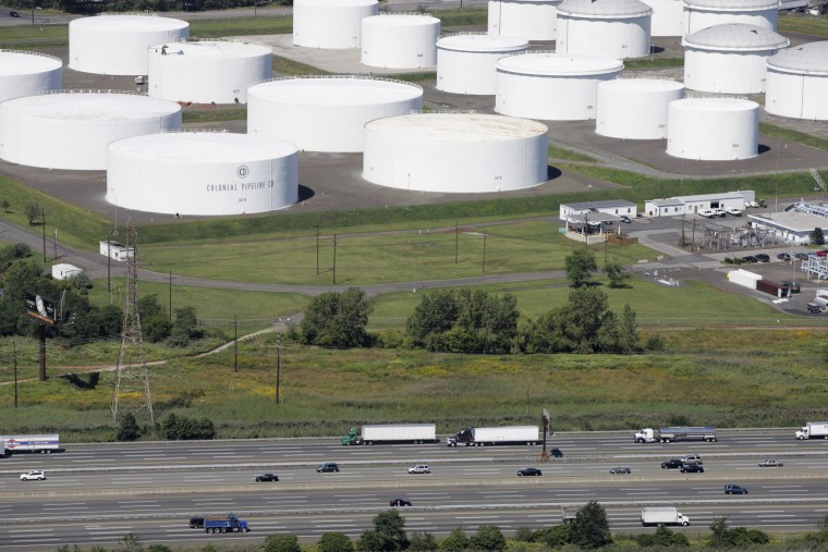 Traffic on I-95 passes oil storage tanks owned by the Colonial Pipeline Company in Linden, N.J., on Sept. 8, 2008.