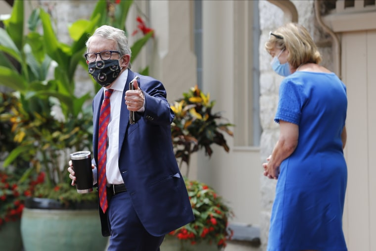 Image: Ohio Governor Mike DeWine, and his wife Fran, walk into their residence in Bexley, Ohio on Aug. 6, 2020.
