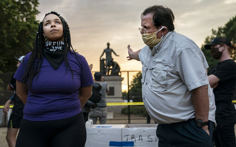 Anais, 26, who wants to remove the Emancipation statue in Lincoln Park in Washington argues with a man who wants to keep it on June 25th, 2020.