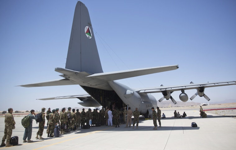 Afghan National Army soldiers line up to get into a C-130 Hercules at Kandahar Air Base on Aug. 18, 2015.