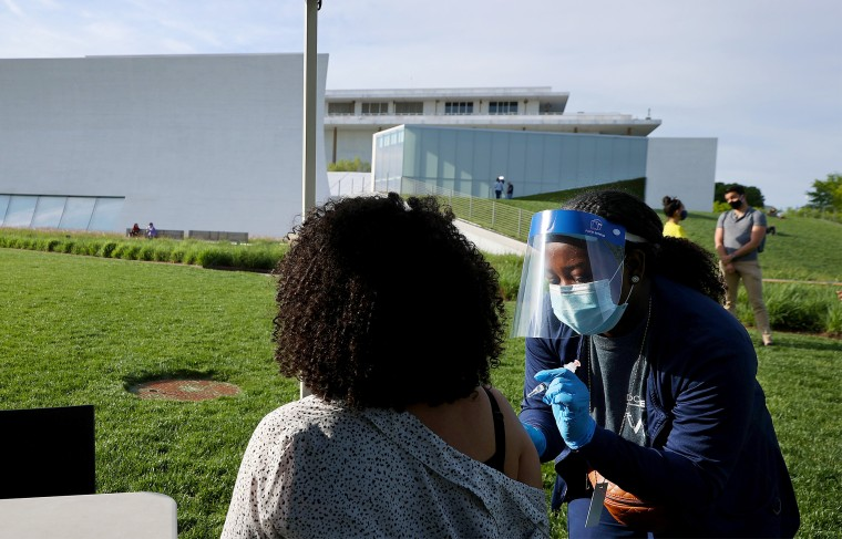 Image: Nurse Kendria Brown from D.C. Health gives a dose of the Johnson Johnson Covid-19 vaccine during a walk-up clinic at the John F. Kennedy Center for the Performing Arts on May 6, 2021 in Washington, DC.