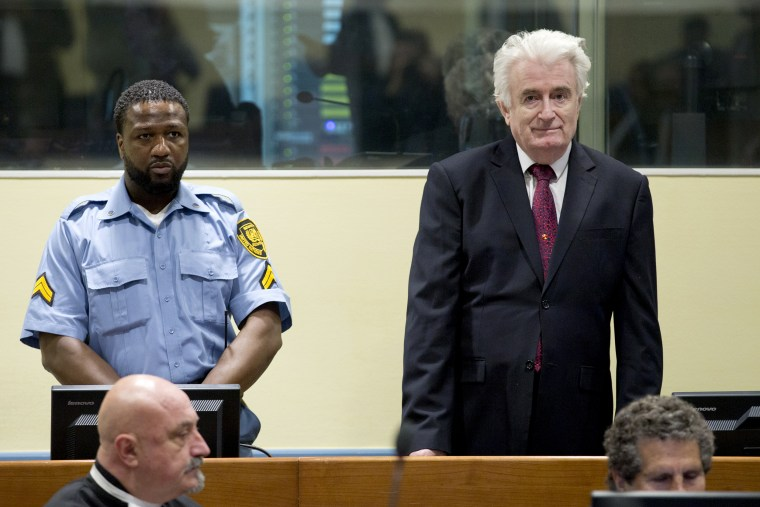 Former Bosnian Serb leader Radovan Karadzic enters the court room of the International Residual Mechanism for Criminal Tribunals in The Hague, Netherlands on March 20, 2019.