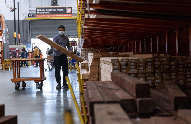 Image: A customer loads lumber at Home Depot