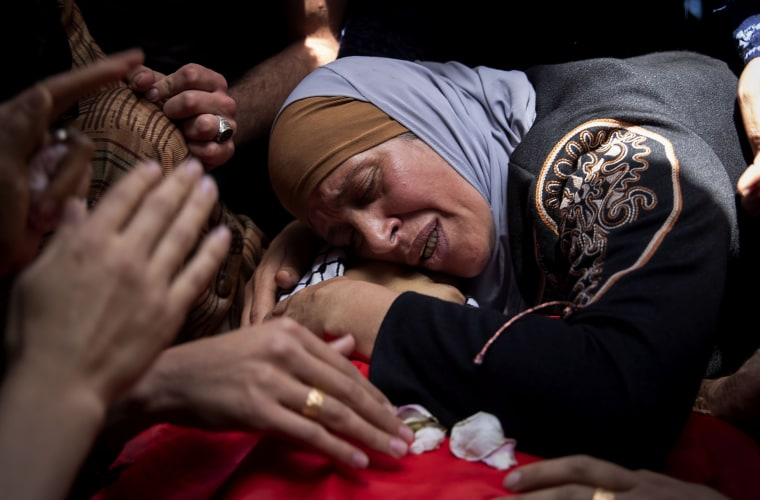 Image: A Palestinian mother mourns over her son, Rasheed Abu Arra, who was killed in clashes with Israeli forces, during his funeral in Aqqaba, near the West Bank town of Tubas, on May 12, 2021.