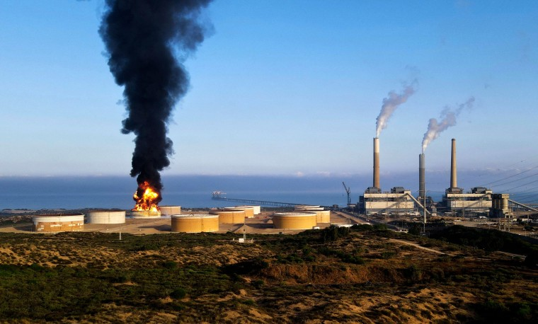 Fire rages early on May 12, 2021 at a refinery in Ashkelon, Israel, hit by Hamas rockets the previous day.