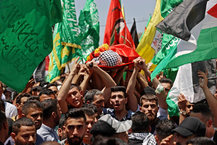 Mourners attend the funeral of Palestinian Rashid Abu Ara, 16, who was killed during clashes with Israeli troops in village of Aqaba near Nablus, West Bank, on May 12, 2021.