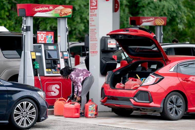Image: A woman fills gas cans at a Speedway gas station on May 12, 2021 in Benson, N.C.