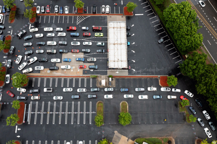Image: Drivers wait in line to refuel vehicles at a Costco Wholesale Corp. gas station in Dunwoody, Ga., on May 12, 2021.