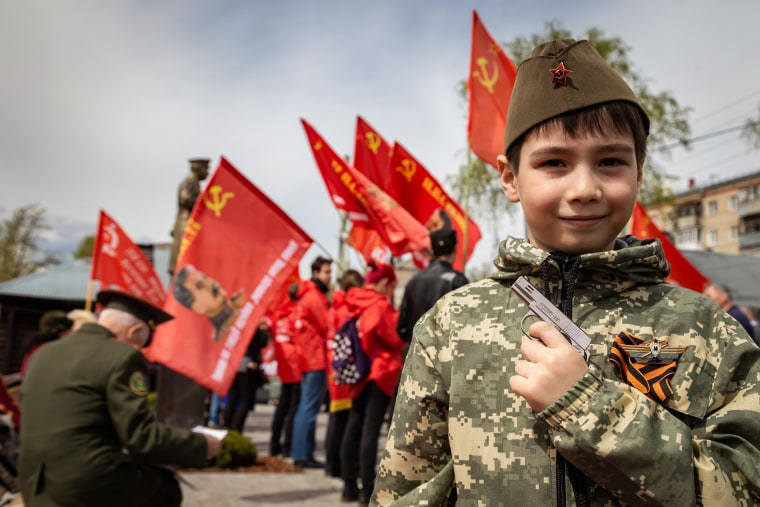 Image: A boy with a toy gun in a children's military uniform at the founding ceremony of the Stalin Center, Bor, Nizhny Novgorod