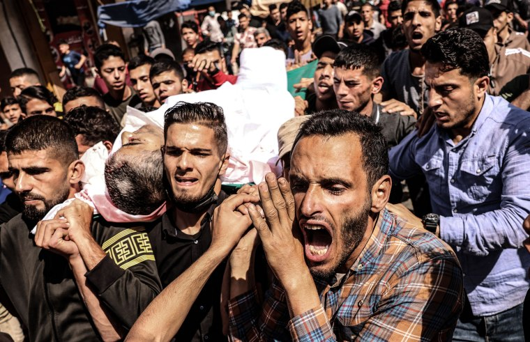 Mourners carry the body of Majd Abu Saadahthe, a Palestinian killed in an Israeli airstike, during his funeral in Khan Yunis in the southern Gaza Strip on May 12.