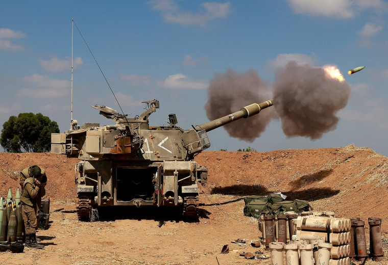 Israeli soldiers fire a 155mm self-propelled howitzer towards the Gaza Strip from their position near the southern Israeli city of Sderot on May 13.