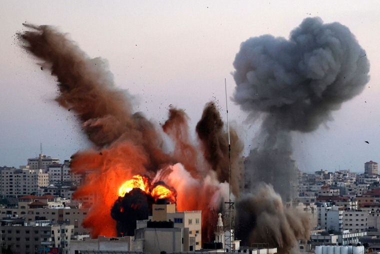 Image: Smoke billows after an Israeli airstrike on Gaza City targeted the Ansar compound, linked to Hamas in the Gaza Strip on May 14, 2021.