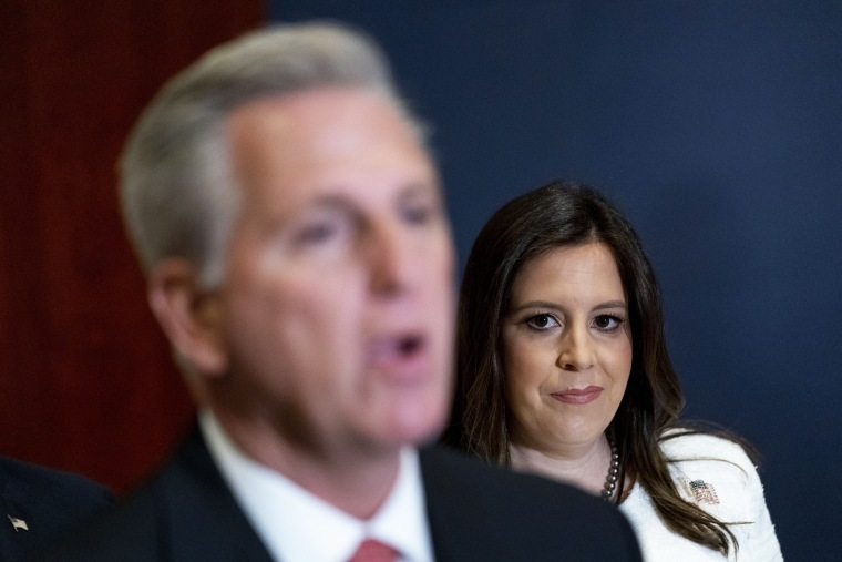 Newly-elected House Republican Conference Chair Rep. Elise Stefanik, R-N.Y., watches as House Minority Leader Kevin McCarthy, R-Calif., speak at the Capitol on May 14, 2021.