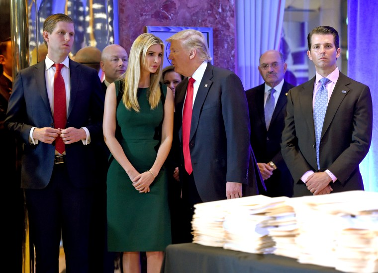 Image: President-elect Donald Trump along with his children Eric, Ivanka and Donald Jr., arrive for a press conference at Trump Tower in New York, accompanied by Allen Weisselberg, chief financial officer of The Trump Organization on Jan. 11, 2017.