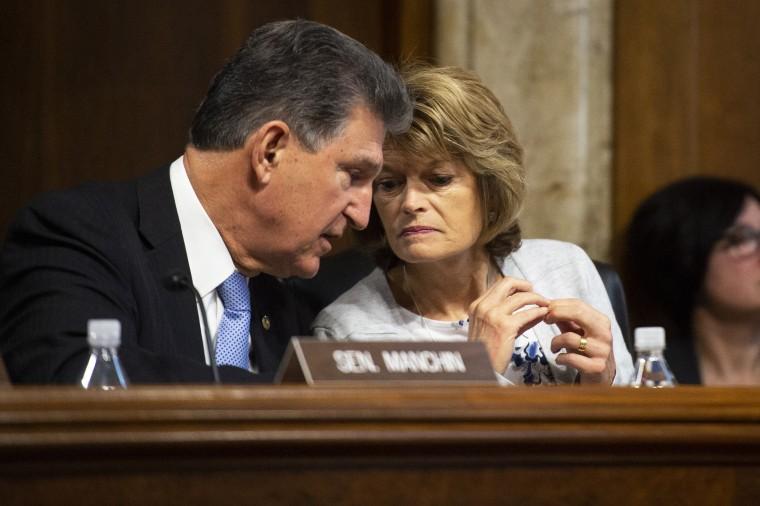 Sen. Joe Manchin, D-W. Va., speaks to Sen. Lisa Murkowski, R-Alaska, during a Senate hearing on March 10, 2020.