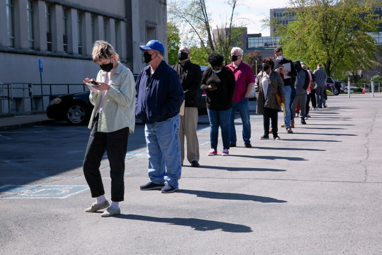 Image: People line up outside a newly reopened career center for in-person appointments in Louisville, Ky.