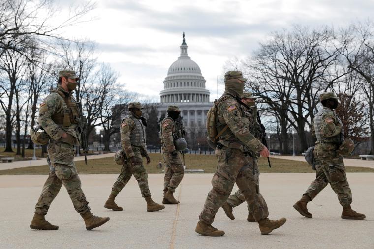 Image: Members of the National Guard patrol near the U.S. Capitol building ahead of U.S. President-elect Joe Biden's inauguration