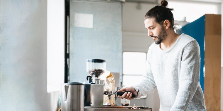 Man preparing espresso with espresso machine