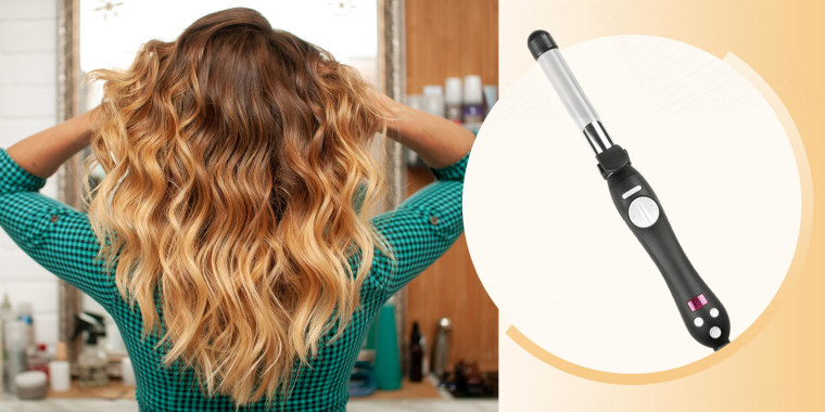 Illustration of a Woman touching her long wavy hair in the bathroom, and the Beachwaver curling iron in black. Is Beachwaver worth the money? How do you use Beachwaver pro? How do you use a beach wave curling iron? What is the best curling iron?