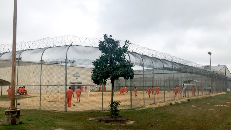 Image: Detained immigrants play soccer behind a barbed wire fence at the Irwin County Detention Center in Ocilla, Ga., on Feb. 20, 2018.