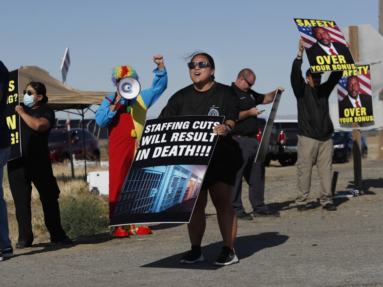 Noni Ahulau, from Honolulu, along with others, protests staffing shortages at the Federal Correctional Institution at Mendota, on May 17, 2021, near the facility, in Mendota, Calif.