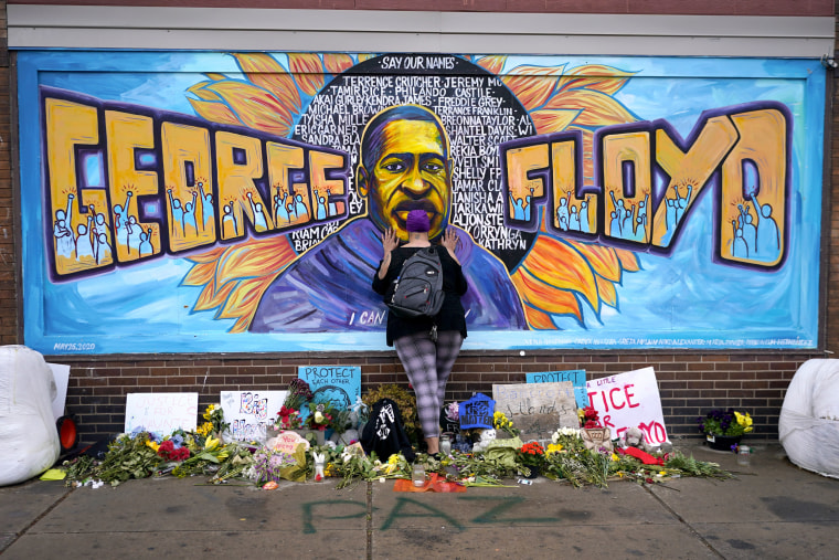 A woman pays respect to George Floyd at a mural on April 23, 2021, in Minneapolis.