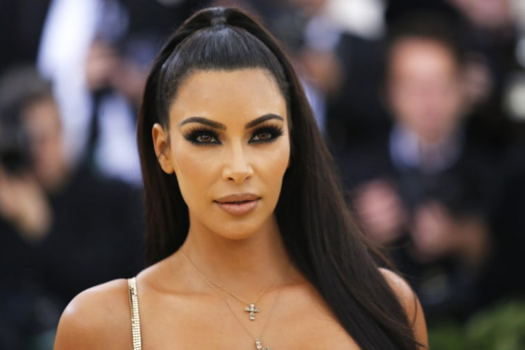 Kim Kardashian looks at the camera at the Met Gala