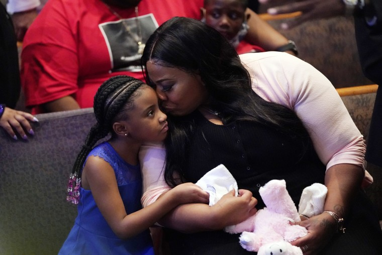 Image: George Floyd's daughter Gianna Floyd, left, sits with Roxie Washington during her father's funeral service at the Fountain of Praise in Houston on June 9.