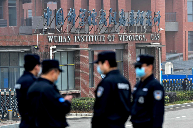 Image:Security personnel stand guard outside the Wuhan Institute of Virology in Wuhan as members of the World Health Organization (WHO) team investigating the origins of the Covid-19 coronavirus make a visit to the institute in Wuhan in China's central Hu