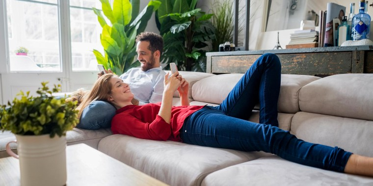 Couple lying on the couch looking at their phones. Memorial Day sales are live now ahead of the holiday. See the best Memorial Day deals on appliances, cookware, furniture, TVs, streaming, apparel and more.