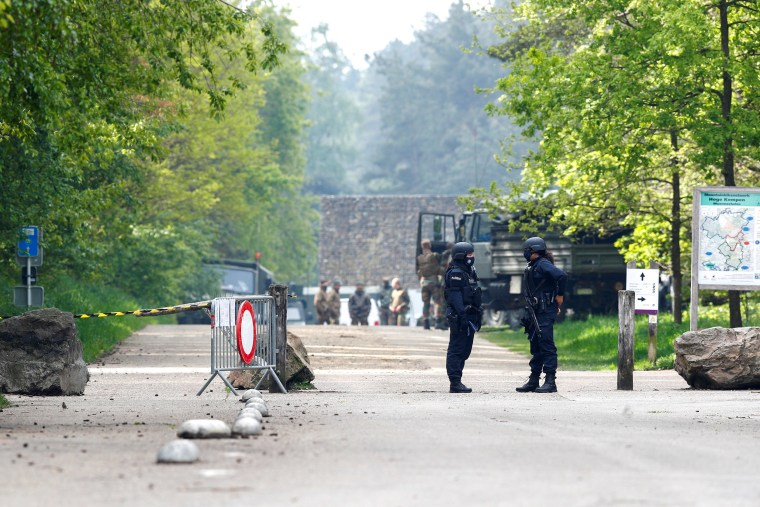Image: Members of the Belgian police and army personnel are seen near the entrance of National Park Hoge Kempen while scouring to capture Belgian Jurgen Conings, in Maasmechelen, Belgium