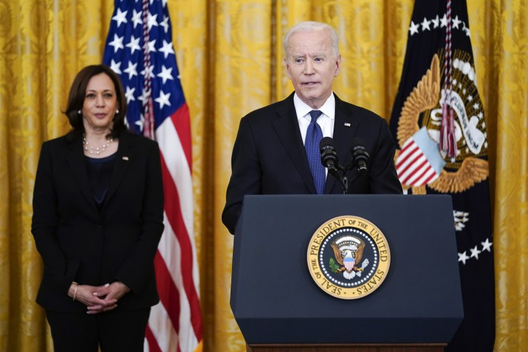 Vice President Kamala Harris listens as President Joe Biden speaks before signing the Covid-19 Hate Crimes Act in the East Room of the White House on May 20, 2021.