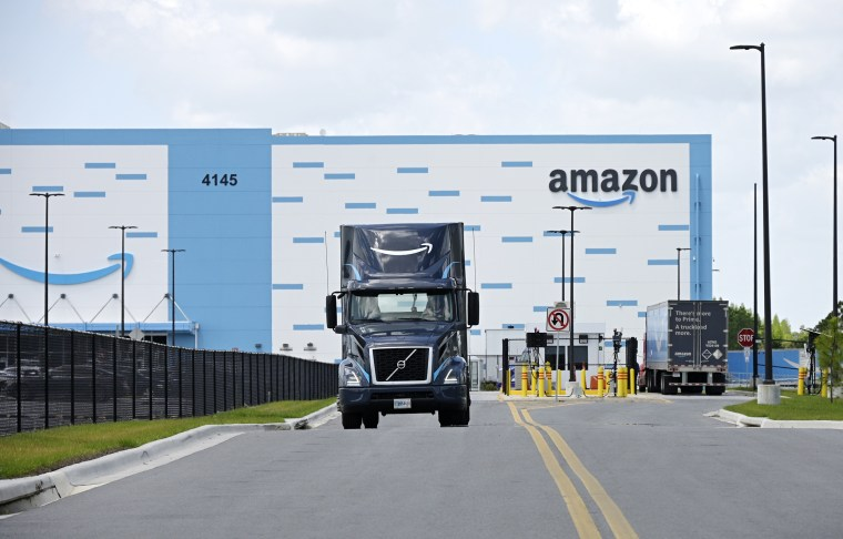 A truck leaves an Amazon facility at Lakeland Linder International Airport in Florida on April 12, 2021.