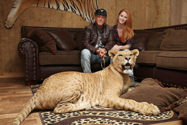 Jeff Lowe and Lauren Dropla with Faith the liliger at their home inside the Greater Wynnewood Exotic Animal Park on Sept. 28, 2016 in Wynnewood, Okla.