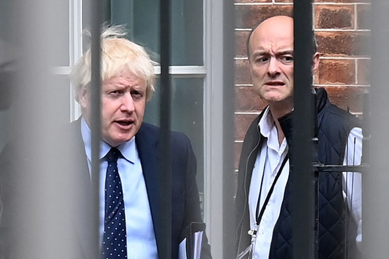 Image: Britain's Prime Minister Boris Johnson and his special advisor Dominic Cummings leave from the rear of Downing Street in central London,
