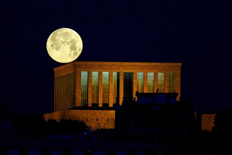 The Super Flood Blood Moon is seen over the Anitkabir, the mausoleum of modern Turkey's founder Mustafa Kemal Ataturk, in Ankara on May 26, 2021.