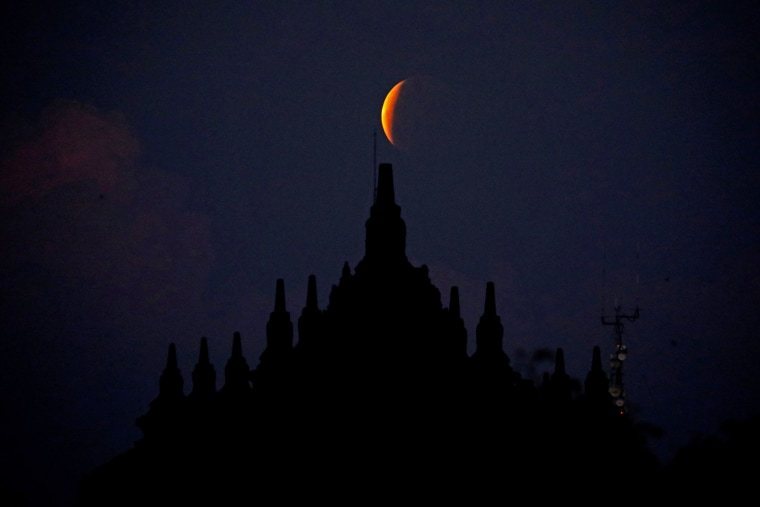 The Super Flower Blood Moon rises over the Plaosan temple in Central Java province, Indonesia, on May 26, 2021.