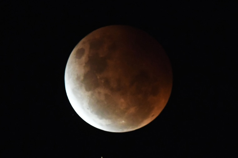 A partial eclipse of the Super Flower Blood Moon over Sydney on May 26, 2021.