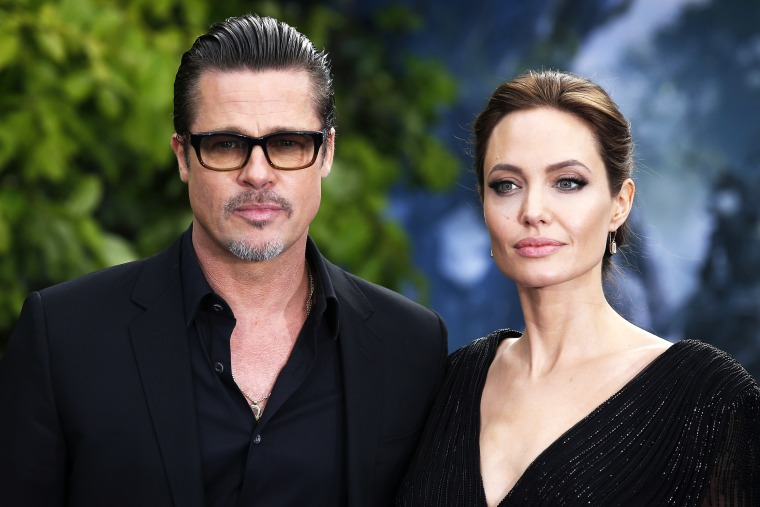Brad Pitt and Angelina Jolie attend the premiere of Maleficent in London on Aug. 5, 2014.