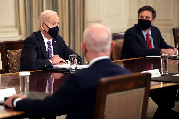 President Joe Biden and Chief of Staff Ron Klain meet with cabinet members and immigration advisors in the State Dining Room on March 24, 2021.
