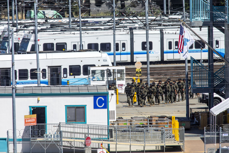 Tactical law enforcement officers move through the Valley Transportation Authority (VTA) light-rail yard where a mass shooting occurred on May 26, 2021 in San Jose, Calif.