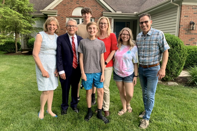Vax-a-Million winner scholarship Joseph Costello, center, with his family and Ohio Gov. Mike DeWine and his wife, left.