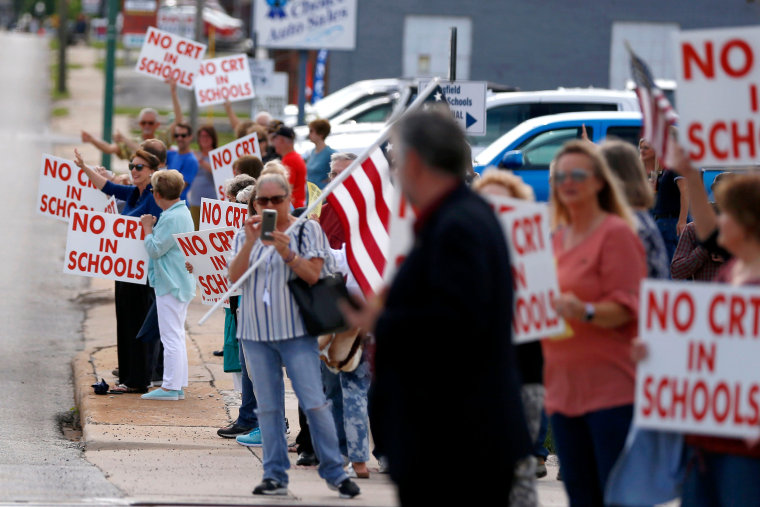 Image: Protesters gather outside the Springfield Public Schools Kraft Administration Building to protest critical race theory being taught in schools in Springfield, Mo., on May 18, 2021.
