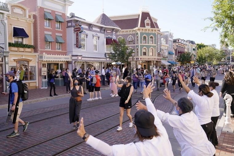 Image: Guests walk down Main Street USA at Disneyland
