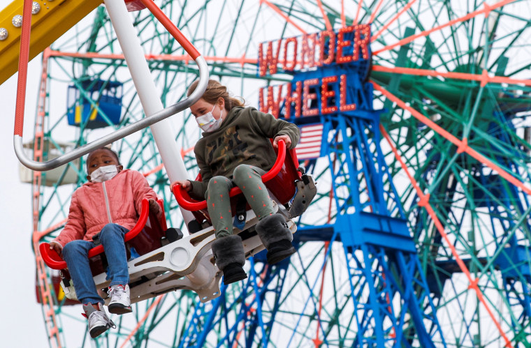 Image: Guests enjoy a ride at Luna Park on the first day of the Coney Island parks reopening in the Coney Island neighborhood of Brooklyn, New York