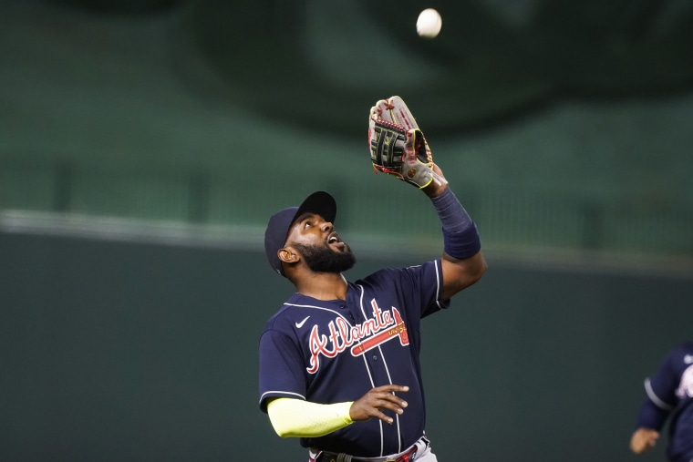 Atlanta Braves left fielder Marcell Ozuna catches a fly ball during a baseball game against the Washington Nationals at Nationals Park in Washington on May 5, 2021.