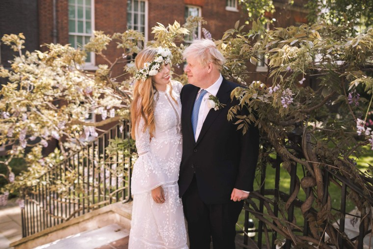 Britain's Prime Minister Boris Johnson and his wife Carrie Johnson in the garden of 10 Downing Street, London, after their wedding on May 29, 2021.