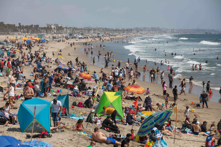 People enjoy a day at the beach ahead of Memorial Day in Santa Monica, Calif., on May 29, 2021.