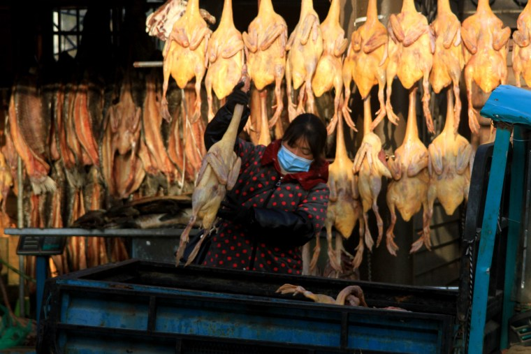 Image: Salted chickens, ducks and fish for sale at a market in Huai an, Jiangsu province in China.